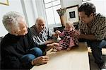 Baby girl with father and grandparents Stock Photo - Premium Royalty-Free, Artist: CulturaRM, Code: 6114-06606170