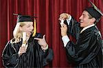 Young graduates Stock Photo - Premium Royalty-Free, Artist: Blend Images, Code: 6114-06606179