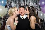 Boy being kissed by two girls Stock Photo - Premium Royalty-Free, Artist: Westend61, Code: 6114-06606183