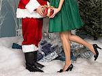 Santa handing a present to a woman Stock Photo - Premium Royalty-Free, Artist: Robert Harding Images, Code: 6114-06606226
