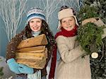Siblings carrying logs and a tree Stock Photo - Premium Royalty-Free, Artist: Cultura RM, Code: 6114-06606227