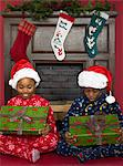 Children looking at presents Stock Photo - Premium Royalty-Free, Artist: Blend Images, Code: 6114-06606238