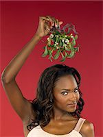 Woman holding mistletoe Stock Photo - Premium Royalty-Freenull, Code: 6114-06606241