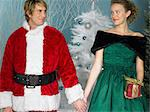 Santa and woman holding hands Stock Photo - Premium Royalty-Free, Artist: Robert Harding Images, Code: 6114-06606246