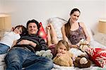 Family relaxing on bed Stock Photo - Premium Royalty-Free, Artist: Cultura RM, Code: 6114-06606254
