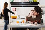Baby and parents in kitchen Stock Photo - Premium Royalty-Free, Artist: Westend61, Code: 6114-06606258