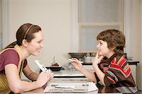 Mother helping son with mathematics Stock Photo - Premium Royalty-Freenull, Code: 6114-06606259