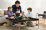 Father and kids playing game Stock Photo - Premium Royalty-Free, Artist: CulturaRM, Code: 6114-06606267
