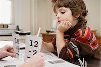 Boy learning mathematics Stock Photo - Premium Royalty-Freenull, Code: 6114-06606268