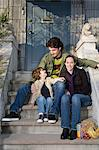 Family sitting on steps Stock Photo - Premium Royalty-Free, Artist: Blend Images, Code: 6114-06606271