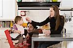 Parents feeding baby Stock Photo - Premium Royalty-Free, Artist: Raymond Forbes, Code: 6114-06606273