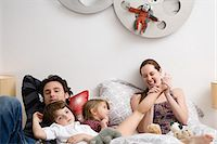 Family on bed Stock Photo - Premium Royalty-Freenull, Code: 6114-06606280