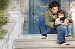 Father and son outside house Stock Photo - Premium Royalty-Free, Artist: Robert Harding Images, Code: 6114-06606282