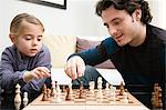 Father and daughter playing chess Stock Photo - Premium Royalty-Free, Artist: Blend Images, Code: 6114-06606284