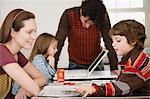 Parents teaching children Stock Photo - Premium Royalty-Free, Artist: Blend Images, Code: 6114-06606289