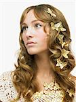 Woman with gold butterflies in her hair Stock Photo - Premium Royalty-Free, Artist: Minden Pictures, Code: 6114-06606294