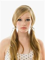 Young woman with her hair in pigtails Stock Photo - Premium Royalty-Freenull, Code: 6114-06606330