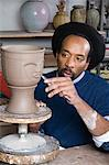 Man sculpting a face into vase Stock Photo - Premium Royalty-Free, Artist: Blend Images, Code: 6114-06606353
