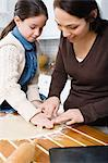 Mother and daughter making cookies Stock Photo - Premium Royalty-Free, Artist: Blend Images, Code: 6114-06606388