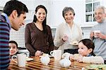 Family in kitchen Stock Photo - Premium Royalty-Free, Artist: Westend61, Code: 6114-06606394