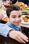 Boy at thanksgiving dinner Stock Photo - Premium Royalty-Freenull, Code: 6114-06606400