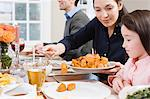 Mother serving sweet potatoes to daughter Stock Photo - Premium Royalty-Freenull, Code: 6114-06606406
