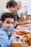 Boy and family saying grace Stock Photo - Premium Royalty-Free, Artist: CulturaRM, Code: 6114-06606408
