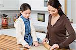 Mother and daughter making cookies Stock Photo - Premium Royalty-Free, Artist: Cultura RM, Code: 6114-06606409