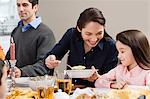Mother serving food to daughter Stock Photo - Premium Royalty-Free, Artist: CulturaRM, Code: 6114-06606420