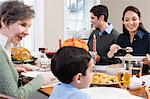 Family at thanksgiving dinner Stock Photo - Premium Royalty-Freenull, Code: 6114-06606435