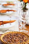 Pecan pie on dining table Stock Photo - Premium Royalty-Freenull, Code: 6114-06606436