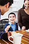 Family having cookies Stock Photo - Premium Royalty-Free, Artist: Blend Images, Code: 6114-06606438