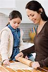Mother and daughter making cookies Stock Photo - Premium Royalty-Free, Artist: Blend Images, Code: 6114-06606441