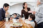 Family in kitchen Stock Photo - Premium Royalty-Free, Artist: Westend61, Code: 6114-06606444