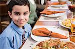 Boy at thanksgiving dinner Stock Photo - Premium Royalty-Freenull, Code: 6114-06606445