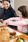 Girl eating thanksgiving dinner Stock Photo - Premium Royalty-Free, Artist: CulturaRM, Code: 6114-06606446