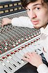 Man using mixing desk Stock Photo - Premium Royalty-Free, Artist: Westend61, Code: 6114-06606452
