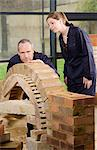 Bricklayer and apprentice Stock Photo - Premium Royalty-Free, Artist: Blend Images, Code: 6114-06606509