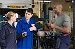Mechanics having coffee break Stock Photo - Premium Royalty-Free, Artist: Blend Images, Code: 6114-06606515