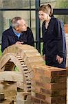 Bricklayer and apprentice Stock Photo - Premium Royalty-Free, Artist: Westend61, Code: 6114-06606522