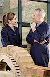 Bricklayer and apprentice Stock Photo - Premium Royalty-Free, Artist: Westend61, Code: 6114-06606531