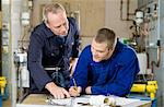 Plumber and apprentice Stock Photo - Premium Royalty-Free, Artist: Blend Images, Code: 6114-06606532
