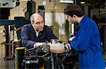 Mechanic and apprentice Stock Photo - Premium Royalty-Free, Artist: Blend Images, Code: 6114-06606535