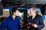 Mechanic and apprentice Stock Photo - Premium Royalty-Free, Artist: CulturaRM, Code: 6114-06606549