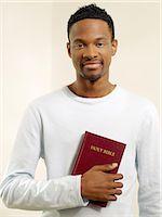 Man holding a bible Stock Photo - Premium Royalty-Freenull, Code: 6114-06606571
