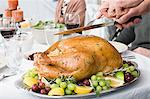 Man carving turkey Stock Photo - Premium Royalty-Freenull, Code: 6114-06606641