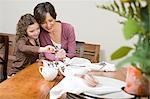 Mother and daughter setting the table Stock Photo - Premium Royalty-Freenull, Code: 6114-06606645
