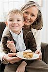 Boy and grandmother with pie Stock Photo - Premium Royalty-Free, Artist: Westend61, Code: 6114-06606646