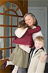 Grandmother hugging grandchildren Stock Photo - Premium Royalty-Free, Artist: Ikon Images, Code: 6114-06606651