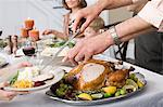 Man serving food Stock Photo - Premium Royalty-Free, Artist: Susan Findlay, Code: 6114-06606665